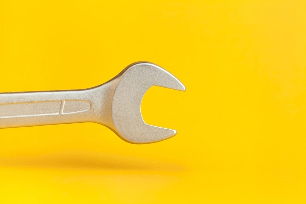 Wrench on yellow background